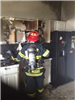 Firefighter in a Burnt Out Kitchen