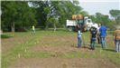 Workers and Equipment Working on the Community Garden