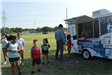 Kids in Line at a Snowcone Trailer
