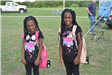 Two Girls Wearing Backpacks