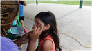 Young Girl Getting Her Face Painted