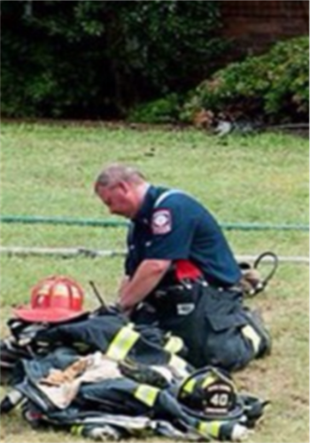 Firefighter Looking at Equipment