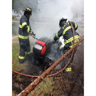 Firefighters Putting out a Lawn Mower Fire