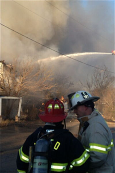 Firefighters with a Hose and Ladder