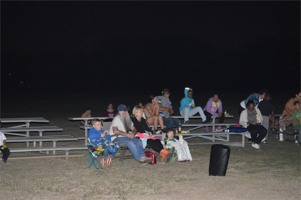 Kids and adults Sitting in Lawn Chairs and Bleachers