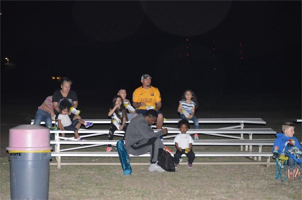 Kids and Adults Sitting on Bleachers