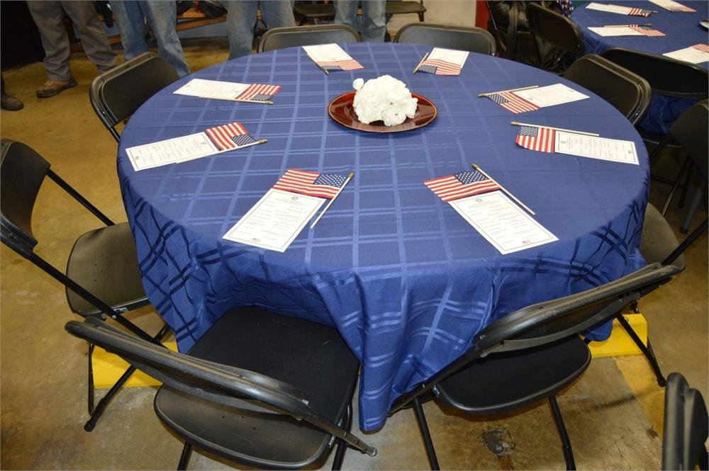 Table Decorated with American Flags and Blue Table Cloth