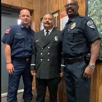 FF C. Garza with Deputy Chief Moore and Chief Burns on 7/9/19